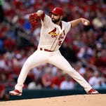 St. Louis Cardinals starting pitcher Jaime Garcia throws