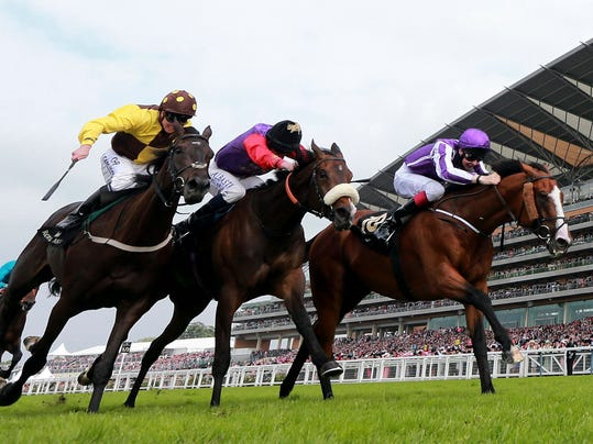 Winner Leading Light ridden by Joseph O'Brien, right,  beats second placed  Estimate ridden by Ryan Moore, centre,  and third placed  Missunited ridden by Jim Crolwey  win the Gold Cup during Day Three of the 2014 Royal Ascot Meeting at ascot England Thursday June 19, 2014. (AP Photo/David Davies/PA)  UNITED KINGDOM OUT