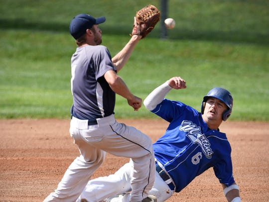 St. Martin's Taylor Holthaus tries to beat the tag