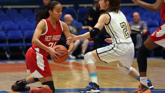North Rockland's Naya Rivera (21) looks for an open teammate while covered by Beacon's Leah Giavatto (2) during the girls Slam Dunk Tournament at the Westchester County Center in White Plains Dec. 26, 2014. North Rockland won the game 56-45.
