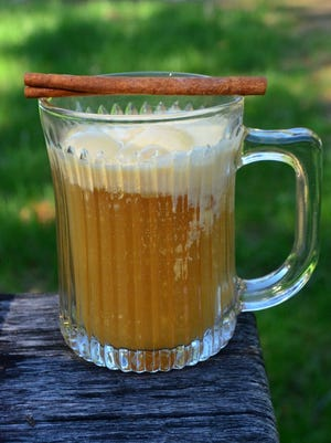 Warm apple cider, potent bourbon and creamy vanilla ice cream make this Apple Cider Bourbon Float a perfect way to end your day.