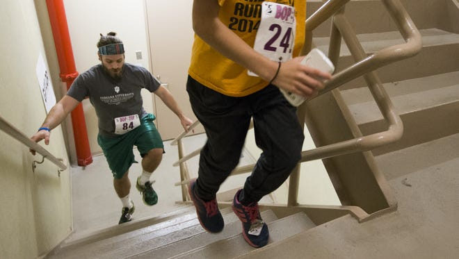 Stephen Purpura (left), Indianapolis, and Isabel Schaefer, 10, Brownsburg, finish up the last flight of Bop to the Top, a 36 floor stair climb benefiting Riley Hospital For Children, at the OneAmerican Tower, Saturday, Jan. 16, 2016.