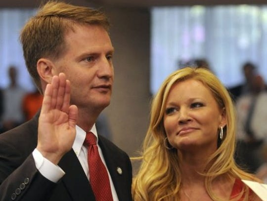 Tim and Allison Burchett when he was sworn in as mayor.