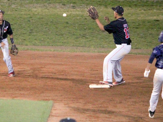 Cobre's Josh Arellano tosses the ball from short to