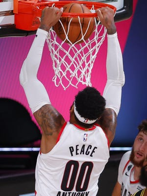 Carmelo Anthony (00) of the Portland Trail Blazers dunks against the Los Angeles Lakers  during the second quarter in Game Four of the Western Conference First Round playoffs on Monday in Lake Buena Vista, Florida.