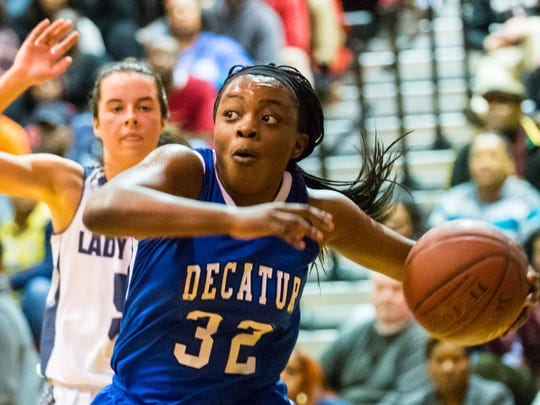 Stephen Decatur guard Dayona Godwin (32) battles to the paint against Kent Island in the Bayside title game at James M Bennett on Thursday, Feb. 25.