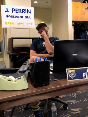 Brewers pitcher Jon Perrin was greeted Tuesday morning with his own financial adviser set-up in the locker room, courtesy of his teammates.