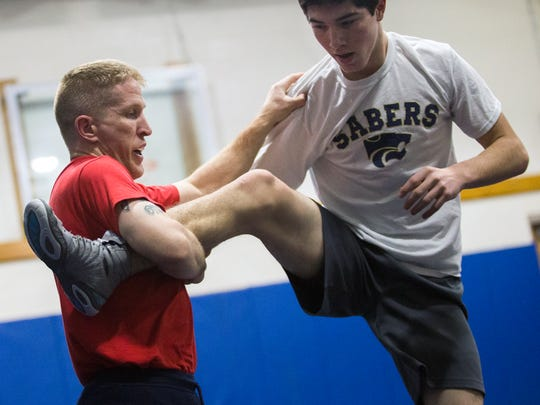 Jason Goldman wrestles Paddy Lupole during a training session on Thursday, Jan. 12 at Susquehanna Valley High School.