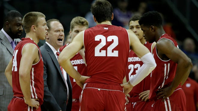 Greg Gard talks to his players during UW's game against UCLA.