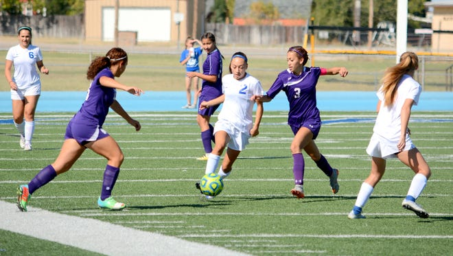 Carlsbad's Baylee Molina moves the ball against Clovis' Dani Rodriguez (3) in the first half Saturday.