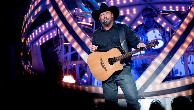 Garth Brooks performs during his opening show at the Denny Sanford Premier Center in Sioux Falls, S.D. on Friday, Sept. 15, 2017.