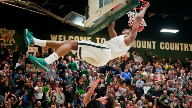 Rice forward #5 Kendrick Gray dunks whatever hope Rutland had left in the last quarter of their semifinal boys high school basketball game Monday night at Patrick Gym, pulling Rice ahead by more the 15 points with minutes left. Rice dominated much of the night, beating Rutland 54-35.