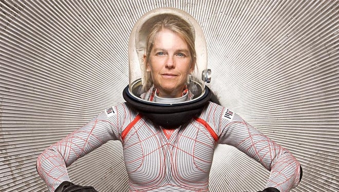 Dava Newman poses wearing a prototype of the BioSuit she and a team of engineers developed at MIT. The new generation spacesuit is lighter and offers greater mobility to astronauts than conventional gas-pressurized spacesuits.