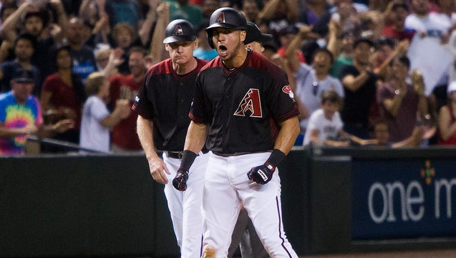 Diamondbacks' David Peralta celebrates after hitting an RBI triple against the Marlins on Saturday, June 11, 2016, at Chase Field in Phoenix.