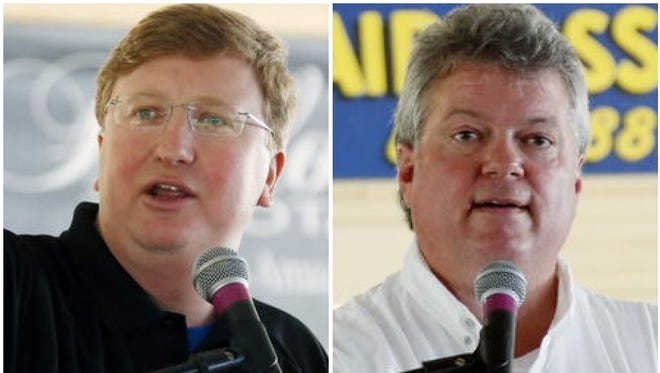 Lt. Gov. Tate Reeves and Attorney General Jim Hood speak Wednesday at the Neshoba County Fair near Philadelphia.