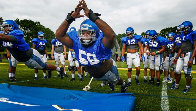 August 11, 2016 - University of Memphis defensive lineman Donald Pennington (middle) takes part in diving drills during preseason training camp on the Lambuth Campus in Jackson, Tenn.