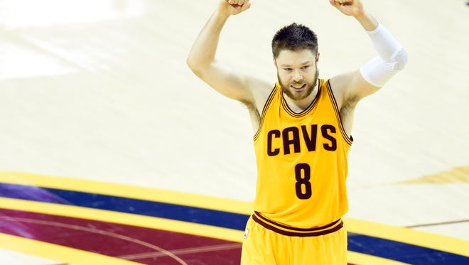 Jun 9, 2015; Cleveland, OH, USA; Cleveland Cavaliers guard Matthew Dellavedova (8) reacts during the fourth quarter of game three of the NBA Finals against the Golden State Warriors at Quicken Loans Arena. Cleveland won 96-91. Mandatory Credit: David Richard-USA TODAY Sports ORG XMIT: USATSI-225716 ORIG FILE ID:  20150609_ajw_ar7_117.jpg