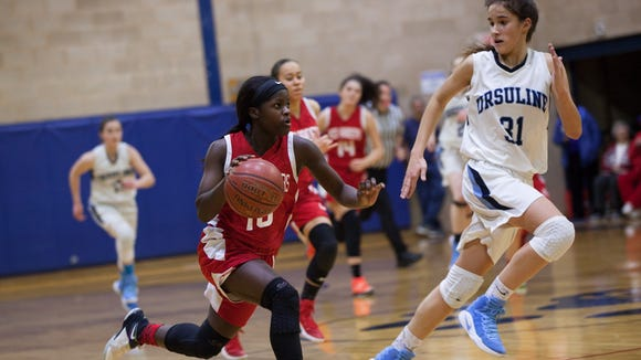 Danielle Cajou (10) drives the ball down court as Sonia Citron (31) tries to maintain cover in the Section 1 Class A girls basketball quarterfinals at The Ursuline School in New Rochelle, February 24, 2017