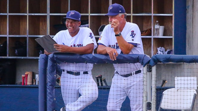 Blue Wahoos pitcher Keury Mella, left, chats with pitching coach Danny Darwin during the game against the Chattanooga Lookouts at Admiral Fetterman Field on Tuesday, July 11, 2017.