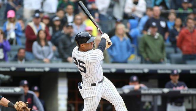 New York Yankees second baseman Gleyber Torres (25) hits a walk off 3 run home run to beat the Cleveland Indians 7-4 at Yankee Stadium.