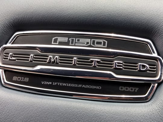 A plaque on the center armrest on the 2018 Ford F-150 Limited gave the truck's vehicle identification number (VIN) and the serial number for how many 2018 F-150 Limited Ford had built. Mark Phelan's test vehicle was #7.