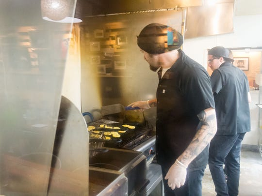 Chefs cook for Golden Ticket winners as other staff performs overnight renovations at Culture in West Ocean City on Thursday, April 21.