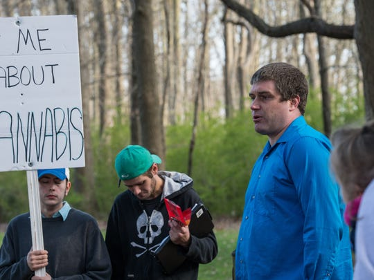 Jerad Halcott, right, speaks to a crowd during a protest