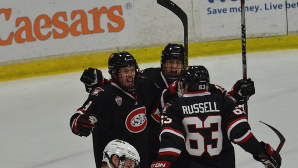 St. Cloud State players celebrate a goal earlier this