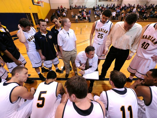 Marian University head basketball coach Todd Lickliter talks to his team during a timeout against Bethel College inside the Physical Education Center, January 11, 2014, in Indianapolis. Twenty-fourth ranked Marian University defeated fourth ranked Bethel College 77-70.