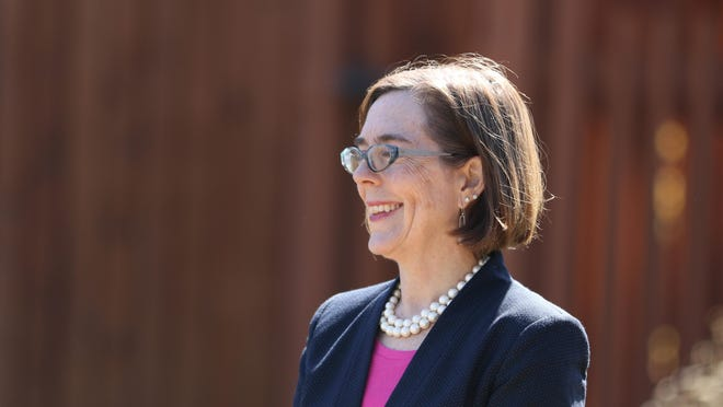 Gov. Kate Brown speaks prior to touring the new innovation center at the Diamond Foods facility on July 15.