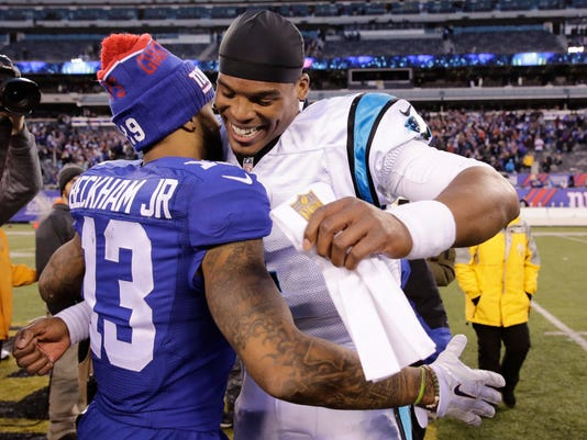 Carolina Panthers' Cam Newton, right, hugs New York Giants' Odell Beckham (13) after an NFL football game Sunday, Dec. 20, 2015, in East Rutherford, N.J. The Panthers won 38-35. (AP Photo/Peter Morgan)