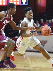 Marist College's Brian Parker drives to the basket