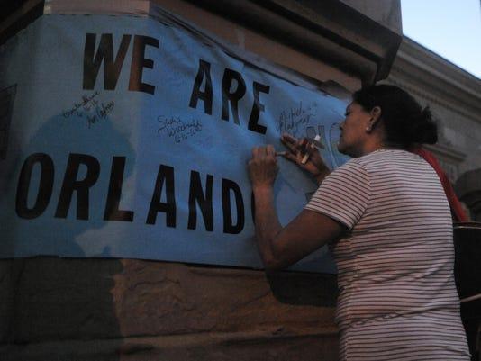 -10 CGO 0616 Vigil for LGBTQ Orlando.JPG_20160616.jpg