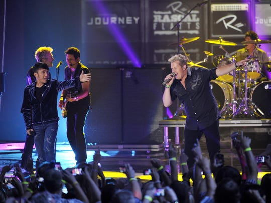 """In 2012 Rascal Flatts closed the show with """"Banjo,"""" featuring a surprise appearance by rock band Journey."""