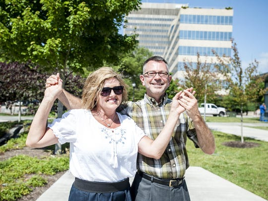 Loretta Freeman and Kevin Hamlin, two organizers of Shindig on the Green, demonstrate a clogging posture in Pack Square Park. The two have been dancing together for 46 years and will perform in the 2015 season of Shindig on the Green, which starts June 27.