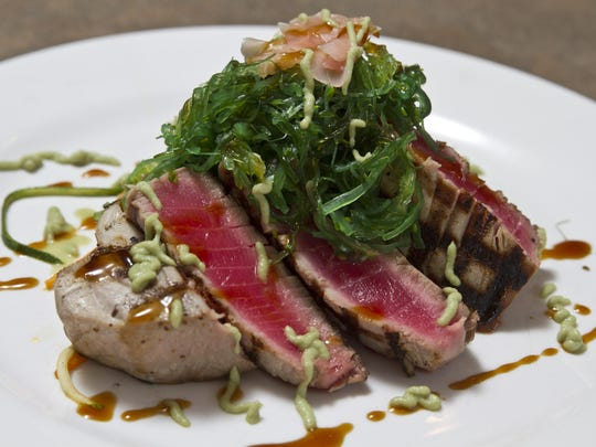 Wasabi tuna, marinated sea greens and pickled ginger in a hot and sweet soy reduction at Runners Seafood Restaurant and Market.