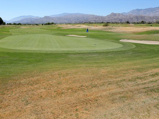 Grass is allowed to go brown in some parts of the golf course at Desert Princess Country Club in Cathedral City on Aug. 4, 2015.