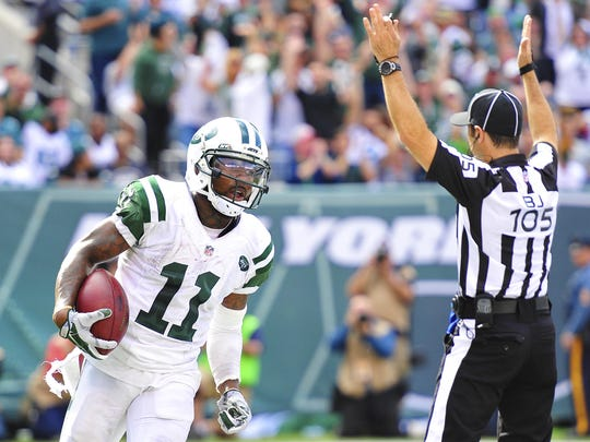 Jets wide receiver Jeremy Kerley (11) scores a touchdown