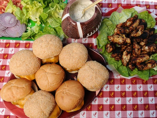 Veteran tailgators suggest planning for food that can be eaten with your hands, like burgers and chipotle chicken wings with blue cheese dip, and prepare in advance, so you don't miss the party.