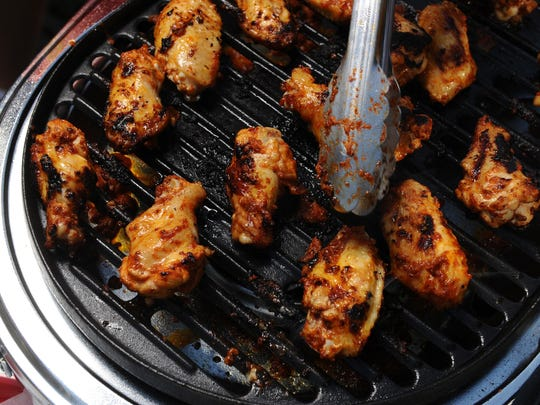 Chipotle-spiced chicken wings can be marinated the night before, so all you have to do on game day is throw them on the grill.
