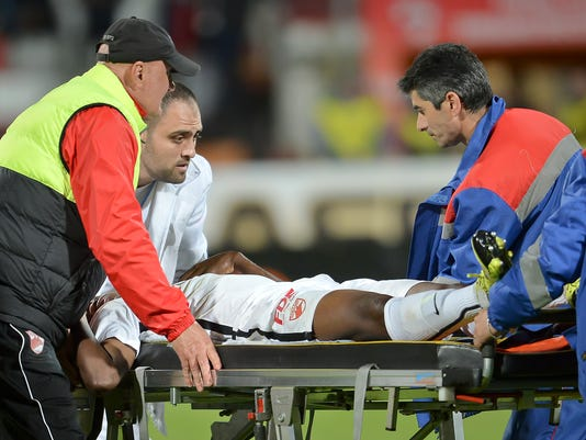 Dinamo's Patrick Ekeng of Cameroon is placed on a stretcher after collapsing during a league game in Bucharest, Romania, Friday, May 6, 2016. Dinamo Bucharest player Patrick Ekeng died after he collapsed during a match in the Romanian capital on Friday, doctors said. He was 26. (AP Photo/Alex Dobre) ROMANIA OUT