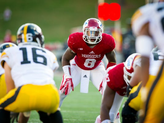 FILE - In this Nov. 7, 2015, file photo, Indiana linebacker Tegray Scales (8) watches the Iowa offense during the first half of an NCAA college football game in Bloomington, Ind. Indiana's defense revolves around Scales and cornerback Rashard Fant. Scales, a senior from Cincinnati, led the nation in tackles for loss (23 1/2) last season and finished with 93 tackles. (AP Photo/Doug McSchooler, File)
