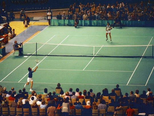 Bobby Riggs, bottom, and Billie Jean King compete during