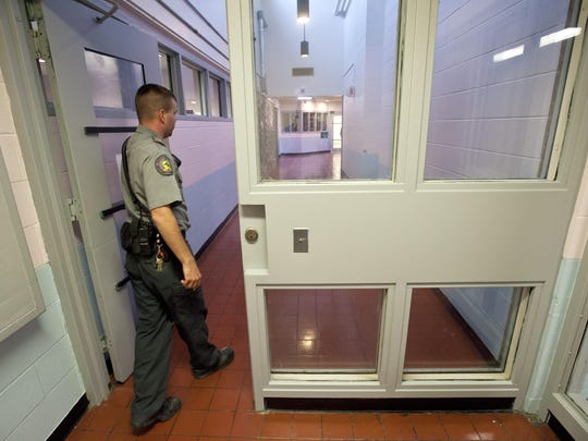 Supervisor Roy Catella conducts a tour of the Chittenden Regional Correctional Facility in South Burlington in 2012.