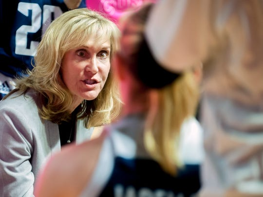 FILE - In this Feb. 7, 2019, file photo, Rice coach Tina Langley talks to players during an NCAA college basketball game against Western Kentucky, in Bowling Green, Ky. Buoyed by the second-longest winning streak in the country, Rice has entered The Associated Press women's basketball poll for the first time in school history. The Owls have won 15 straight games and are ranked 25th in Monday's poll. (Bac Totrong/Daily News via AP, File)/
