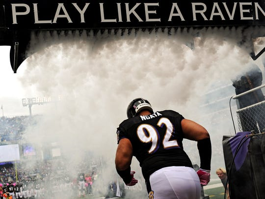 BALTIMORE, MD - OCTOBER 13:  Haloti Ngata runs through smoke as he is introduced before playing the Green Bay Packers at M&T Bank Stadium on October 13, 2013 in Baltimore, Maryland. (Photo by Patrick Smith/Getty Images)