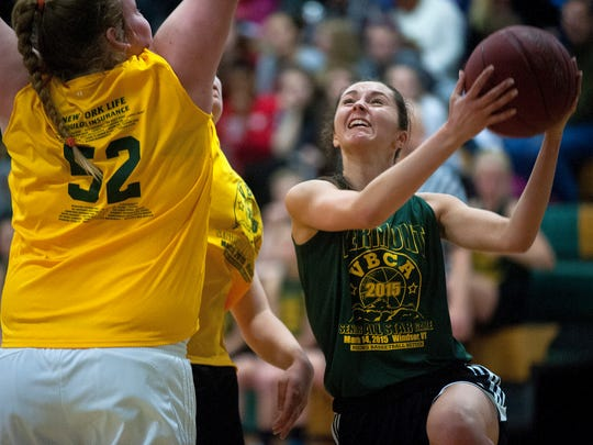 Colchester's Alex Richard, right, drives for a layup during the VBCA's Division I and II senior all-star game on Saturday at Windsor High School.