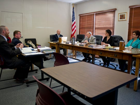 Members of the Vermont Liquor Control Board along with Assistant Attorney General Jacob Humbert (far left) and Director of Education, Licensing and Enforcement William Goggins (inner left) prepare for hearings in Montpelier earlier this month.
