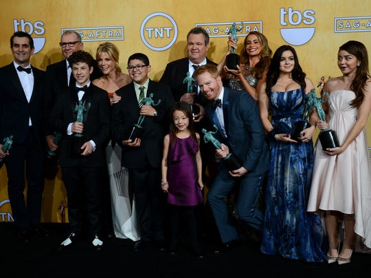 """The cast of """"Modern Family"""" celebrate their win for  Outstanding Performance by an Ensemble in a Comedy Series in the press room during the 20th annual Screen Actors Guild Awards on Jan. 18, 2014 in Los Angeles, Calif."""