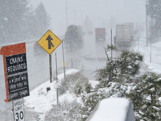 Vehicles make their way west on I-80 just past Truckee during a spring snowstorm on Tuesday.